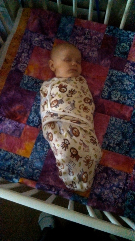 You know you're a mom when you feel the need to document your child's first nap in the crib.