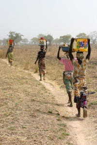Women in Northern Ghana carry the responsibility of fetching water for household chores. Credit: Catherine Ryan Gregory