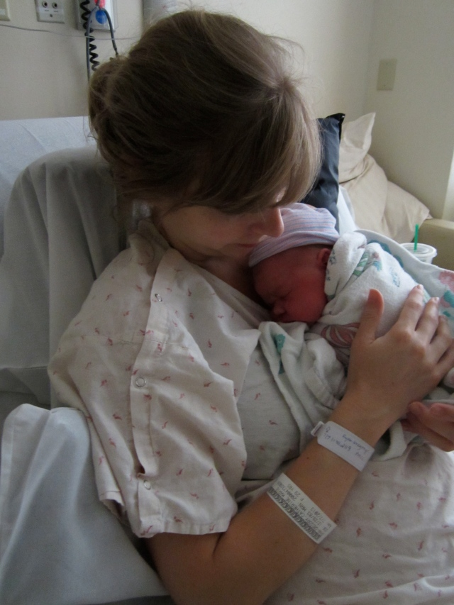 day-old newborn with mom hospital