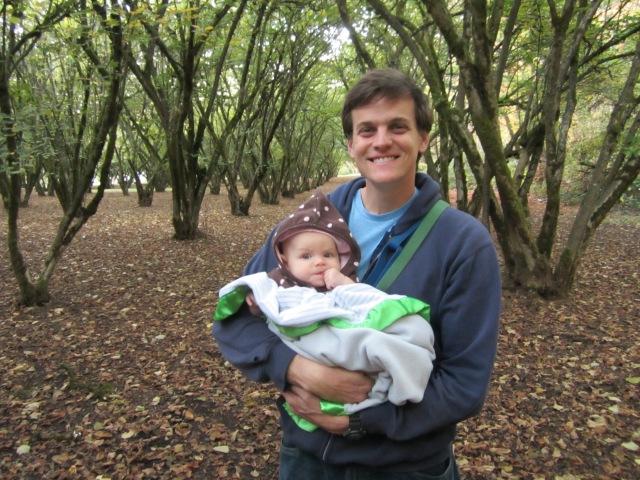 dad carrying baby hazelnut orchard Eugene Oregon Dorris Park