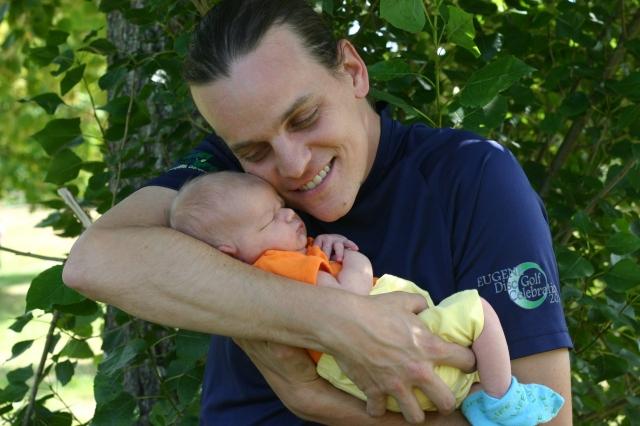 Dad hugging newborn