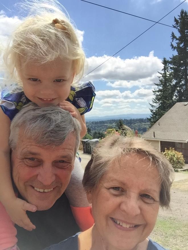 Grandparents piggy back ride